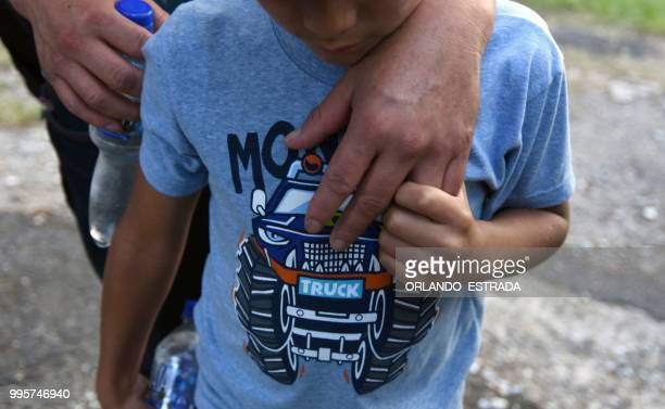 Members of a Guatemalan immigrant family who tried to illegally cross to the United States arrive at the Air Force base in Guatemala City after being...