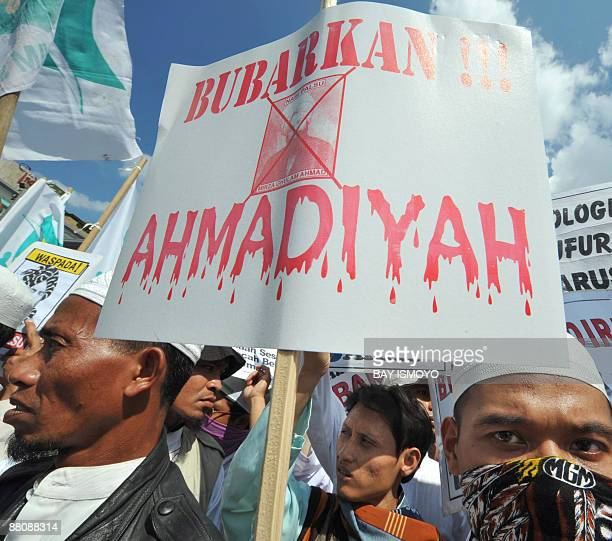 Members of a hardline Muslim group take part in a rally during a protest in Jakarta on June 1 2009 demanding the three candidates on the July 8...
