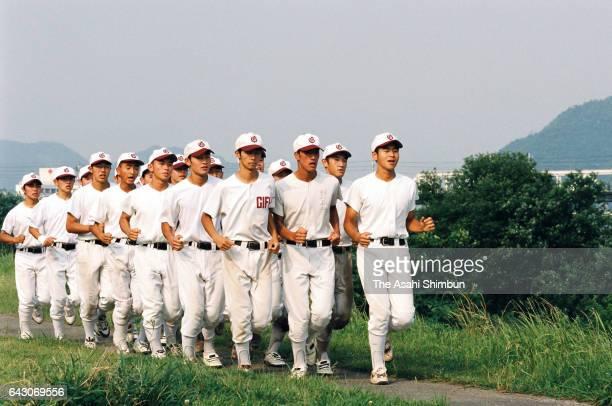 Members of a high school baseball team run at the bank of Nagaragawa River on June 18 1998 in Gifu Japan