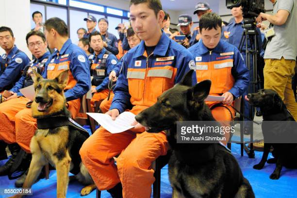 Members of a Japanese rescue team dispatched to Mexico City are seen on arrival at Narita International Airport on September 28 2017 in Narita Chiba...