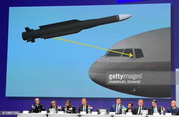 TOPSHOT Members of a joint investigation team present the preliminary results of the criminal investigation into the downing of Malaysia Airlines...
