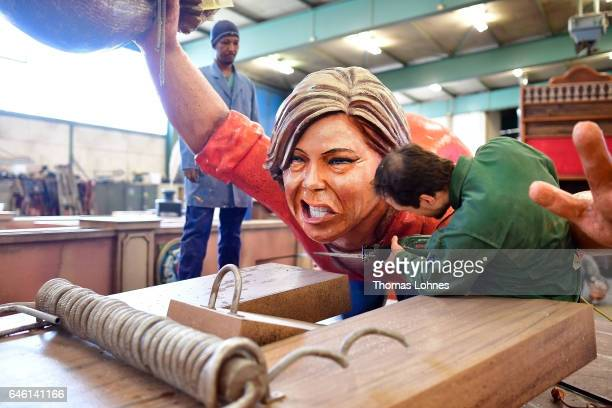Members of a local carnival association take apart a float showing Julia Kloeckner the Chairman of the CDU of Rhineland Palatinate the day after the...