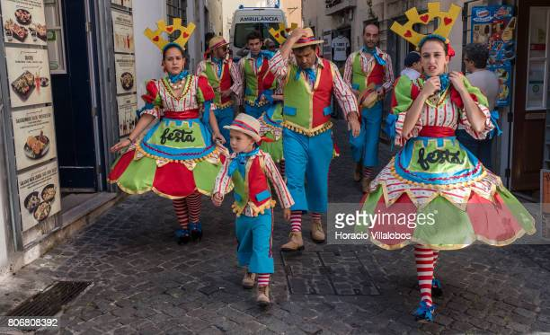 Members of a local marcha dress in costume to parade outside the castle in Bairro do Castelo neighborhood one of the city's oldest district and a...