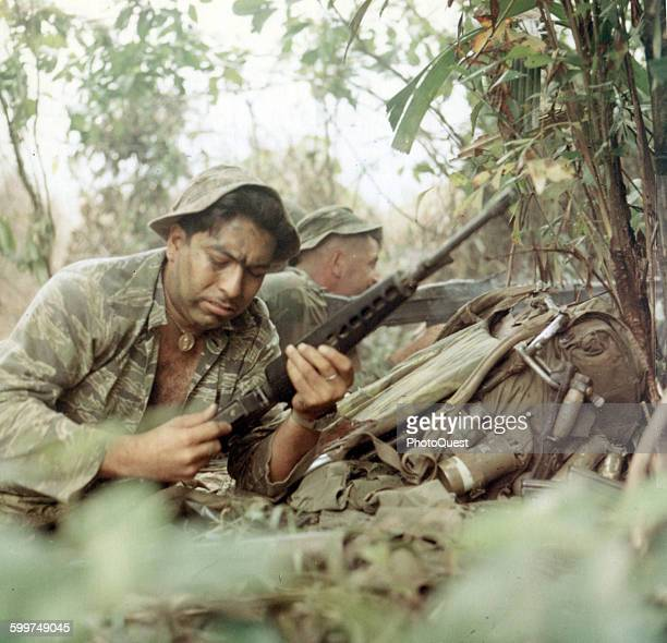LRRP Members of a Long Range Patrol Team open fire against the enemy Viet Nam September 19 1969 R1 are SP4 Salvador Romero Senior Scout Observer with...