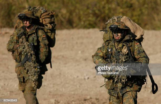 Members of a long range reconaissance patrol operate during the annual military exercises held for the media at the Bergen military training grounds...