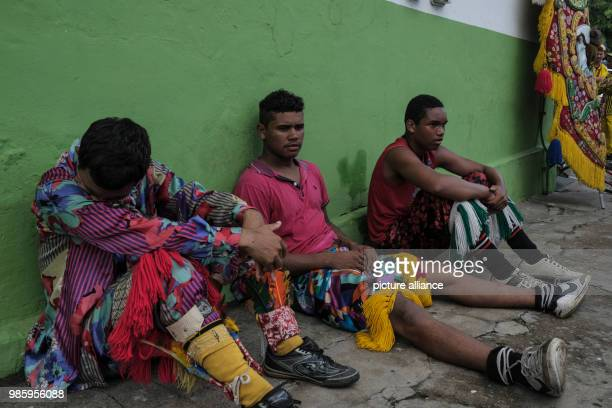 Members of a Maracatu group taking a break after a carnival parade in Nazare de Mata Brazil 13 February 2018 Nazare de mata is a small city in...
