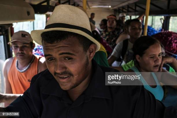 Members of a maracatu group travel to perform a presentation in the city of Nazaré da Mata in Northeast Brazil on January 13 2018