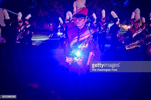 Members of a marching band in the Redlands Christmas Parade stage before the start of the parade Saturday night. 2015 Redlands Christmas Parade...