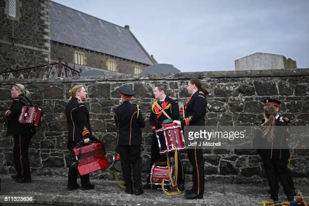 Members of a marching band pause at Drumcree Church on July 9, 2017 in Drumcree, Northern Ireland. The annual Orange marches and demonstrations will...