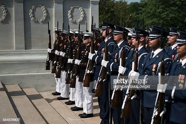 Members of a Marine and Air Force honor guard stand by the Tomb of the Unknowns before Lt Gen Mahmoud Hegazy Chief of Staff of the Egyptian Armed...