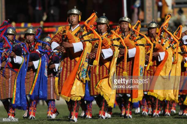 Members of a military band play their instruments during a public ceremony to celebrate the crowning of Bhutan's King Jigme Khesar Namgyel Wangchuck...
