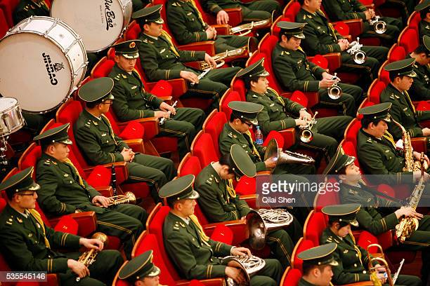 Members of a military band relax with several dozing off during the opening ceremony of the Thirteenth Shanghai Municipal People's Congress in...