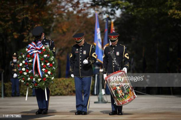 Members of a military honor guard stand as they await the arrival of Vice President Mike Pence for a wreath laying at the Tomb of the Unknown Soldier...