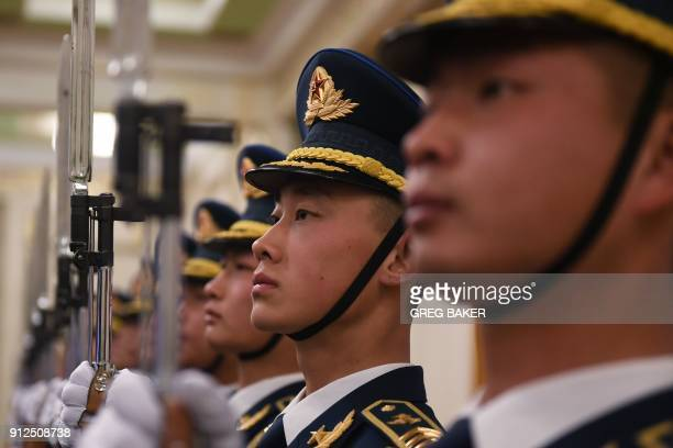 Members of a military honour guard rehearse ahead of a welcome ceremony for British Prime Minister Theresa May in Beijing's Great Hall of the People...