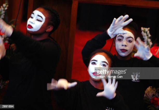 Members of a mime group perform during a rally in support of Democratic Philadelphia Mayor John F Street November 2 2003 in Philadelphia Pennsylvania...