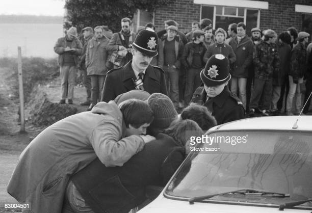Members of a miners' picket at Tilmanstone Colliery Kent try to persuade a colleague not to cross the picket line in the last days of the miners'...
