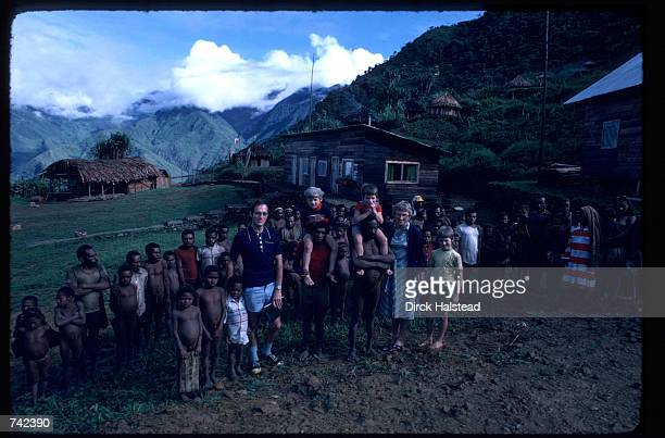 Members of a missionary family stand with tribespeople June 2, 1980 in Irian Jaya, Indonesia. Missionaries render assistance and aid to many remote...