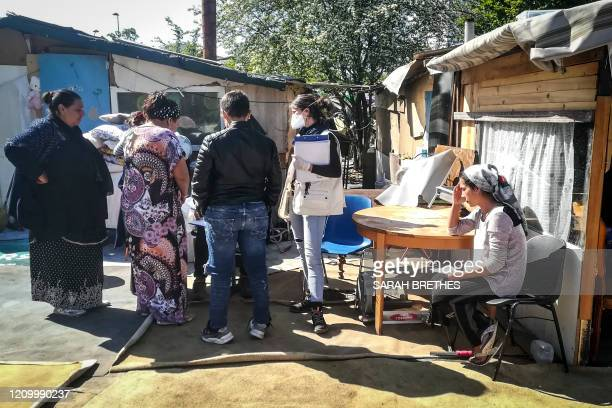 Members of a mobile medical team of the NGO Medecins du monde visits a camp of the Roma community in SaintDenis north of Paris on April 15 on the...