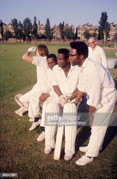 Members of a multi-ethnic cricket team in Finsbury Park, London, circa 1975.