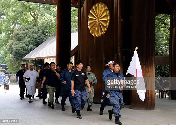 Members of a nationalist group visit the controversial Yasukuni Shrine in Tokyo on August 14 one day before the 70th anniversary of Japan's surrender...