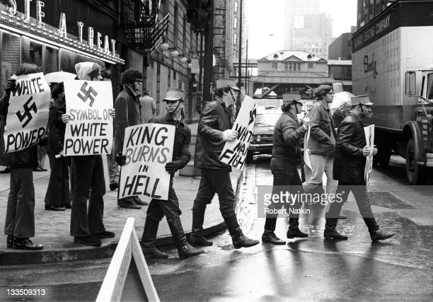 Members of a neoNazi group march in Chicago carrying racist signs 1973