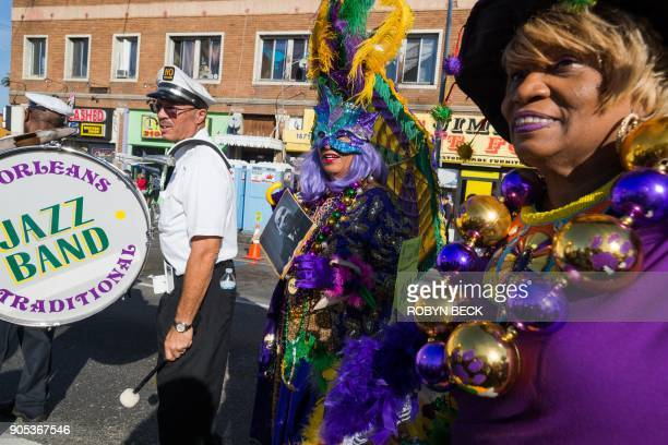 Members of a New Orleansstyle band dressed in Mardis Gras outfits wait to participate in the 33rd annual Kingdom Day Parade honoring Dr Martin Luther...