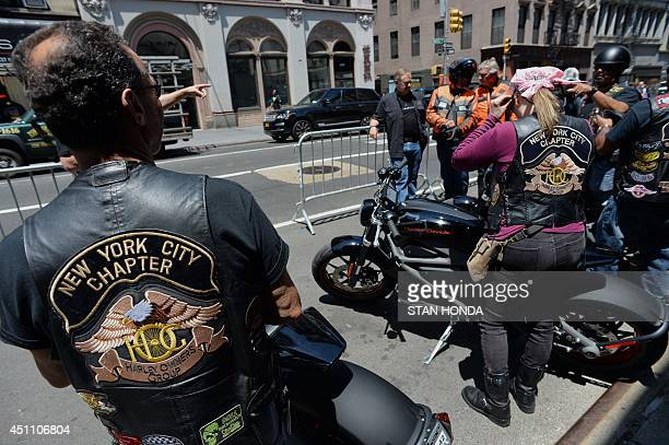Members of a New York City chapter of HarleyDavidson owners prepare to ride the Project LiveWire the company's first electric motorcycle during a...