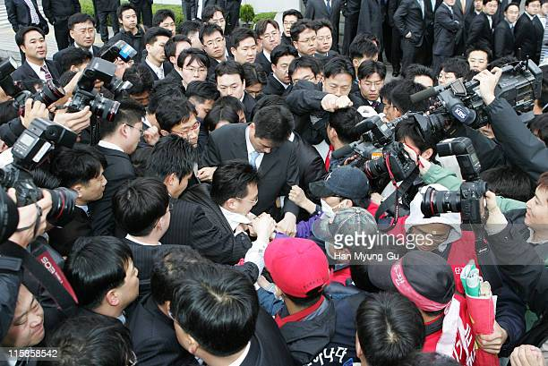 Members of a non fulltime worker's union at Hyundai Motor Corporation scuffle with Hyundai motors employees's security guards during a rally April 20...