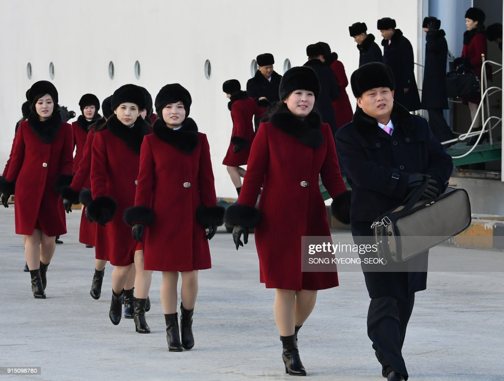 Members of a North Korean arts troupe arrive at Mukho port, in Dongae ahead of the Pyeongchang 2018 Winter Olympic Games on February 7, 2018. The orchestra is scheduled to hold two performances at the Gangneung Art Centre on the eve of the opening ceremony of the February 9-25 Pyeongchang Olympics and at the National Theatre of Korea in Seoul on February 11. / AFP PHOTO / POOL / Song Kyeong-Seok