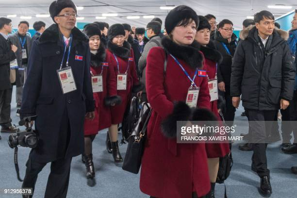 Members of a North Korean delegation of 32 people, including 10 athletes of the North Korean Olympic team, arrive at the Athletes' Olympic Village in...