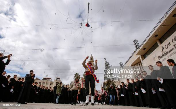 TOPSHOT Members of a Palestinian marching band perform in a parade outside the Church of the Nativity in the Biblical West Bank city of Bethlehem on...