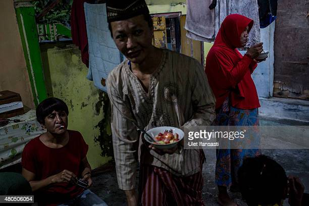 Members of a Pesantren boarding school, Al-Fatah, for transgender people known as 'waria' eat as break their fast during Ramadan on July 12, 2015 in...