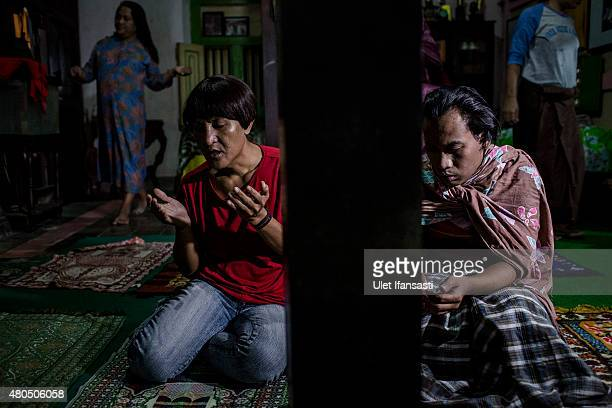 Members of a Pesantren boarding school AlFatah for transgender people known as 'waria' pray during Ramadan on July 12 2015 in Yogyakarta Indonesia...