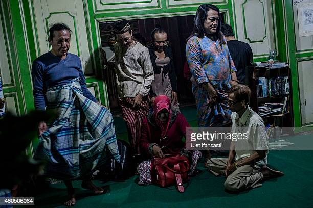 Members of a Pesantren boarding school, Al-Fatah, for transgender people known as 'waria' gather after break their fast during Ramadan on July 12,...