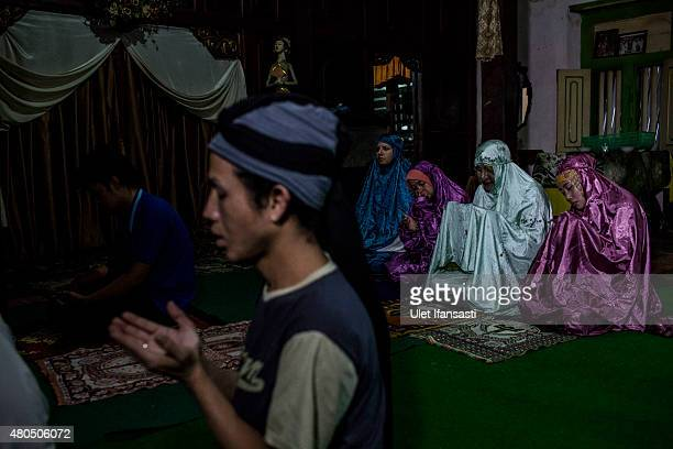 Members of a Pesantren boarding school AlFatah for transgender people known as 'waria' pray during Ramadan on July 08 2015 in Yogyakarta Indonesia...
