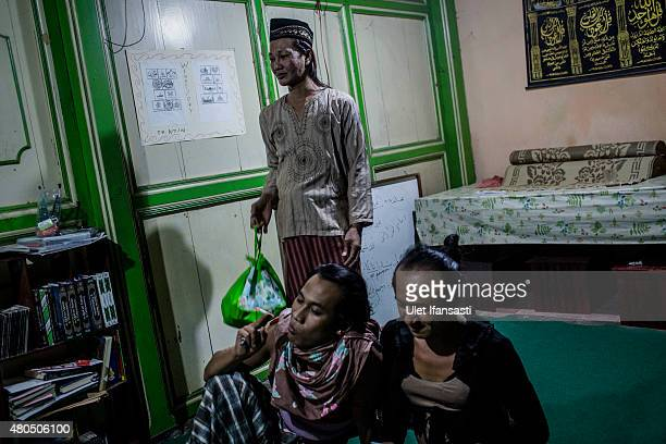 Members of a Pesantren boarding school, Al-Fatah, for transgender people known as 'waria' are seen attend during Ramadan on July 12, 2015 in...