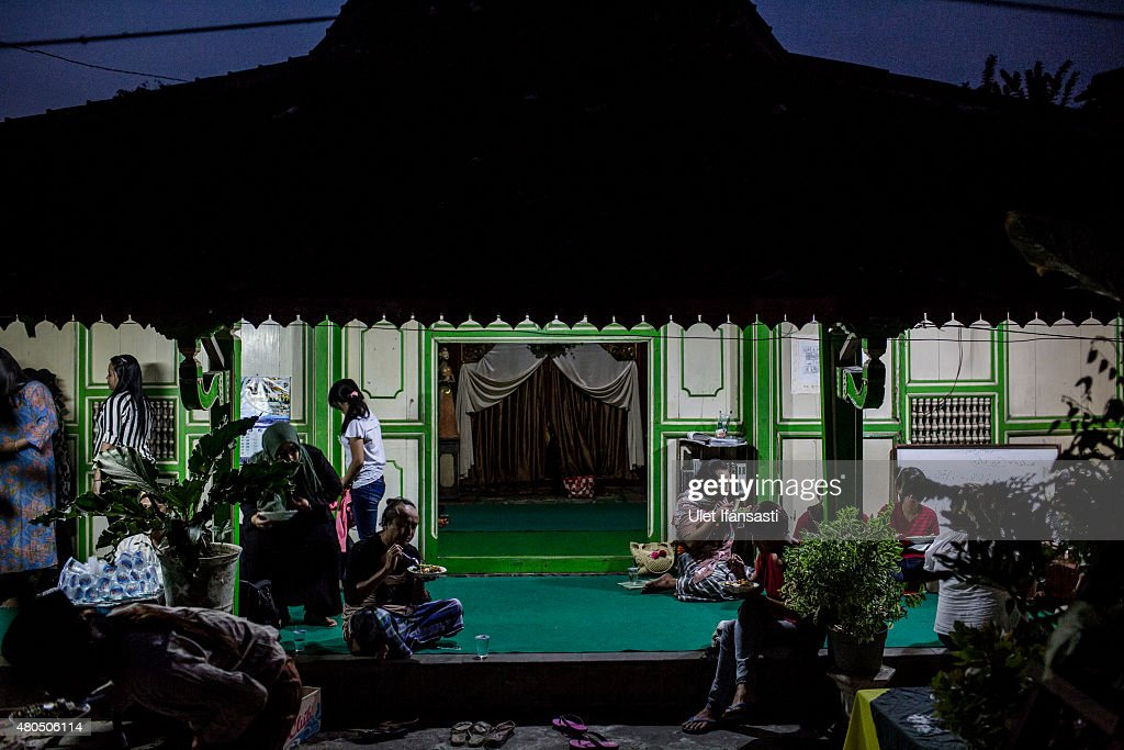 Members of a Pesantren boarding school, Al-Fatah, for transgender people known as 'waria' eat as break their fast during Ramadan on July 12, 2015 in Yogyakarta, Indonesia. During the holy month of Ramadan the 'waria' community gather to break the fast and pray together. 'Waria' is a term derived from the words 'wanita' (woman) and 'pria' (man). The Koran school Al-Fatah was set back last year's by Shinta Ratri at her house as a place for waria to pray, after their first founder Maryani died. The school operates every Sunday. Islam strictly segregates men from women when praying, leaving no-where for 'the third sex' waria to pray before now.
