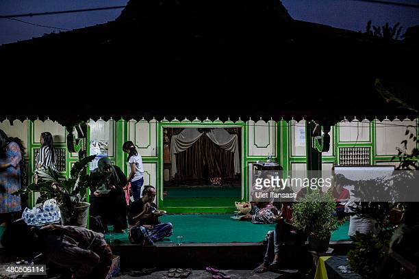 Members of a Pesantren boarding school AlFatah for transgender people known as 'waria' eat as break their fast during Ramadan on July 12 2015 in...