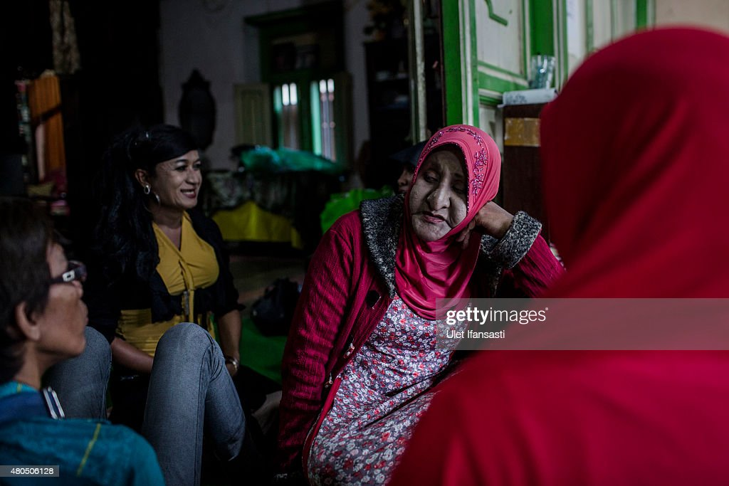 Members of a Pesantren boarding school, Al-Fatah, for transgender people known as 'waria' talking each other as waiting for break the fast during Ramadan on July 12, 2015 in Yogyakarta, Indonesia. During the holy month of Ramadan the 'waria' community gather to break the fast and pray together. 'Waria' is a term derived from the words 'wanita' (woman) and 'pria' (man). The Koran school Al-Fatah was set back last year's by Shinta Ratri at her house as a place for waria to pray, after their first founder Maryani died. The school operates every Sunday. Islam strictly segregates men from women when praying, leaving no-where for 'the third sex' waria to pray before now.