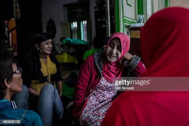 Members of a Pesantren boarding school AlFatah for transgender people known as 'waria' talking each other as waiting for break the fast during...