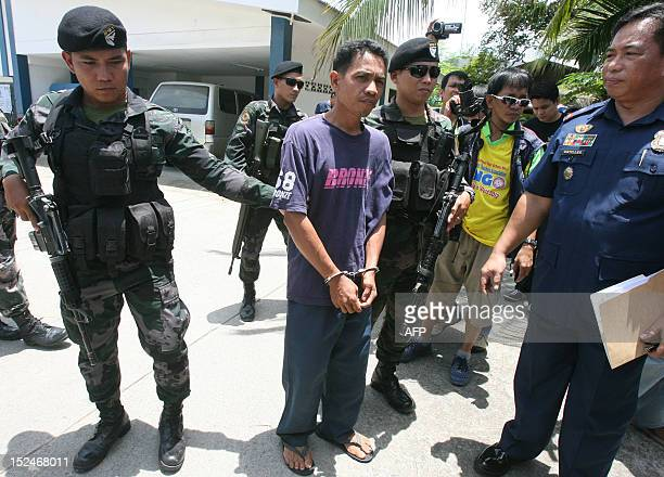 Members of a police commando escort suspected Al Qaedalinked group Abu Sayyaf member Sambri Kamlon in a police camp in Zamboanga City in the southern...