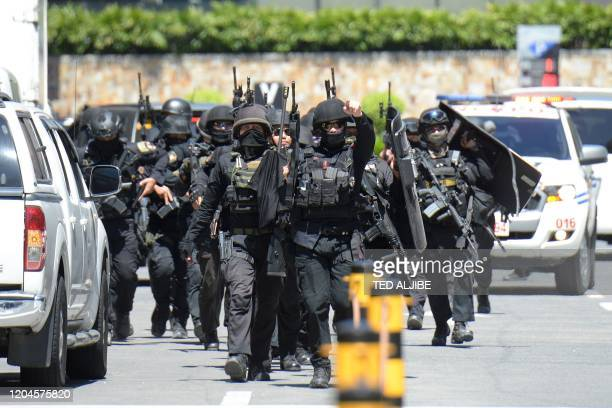 Members of a police SWAT team arrive after a hostage situation was reported at a mall in suburban Manila in March 2, 2020.