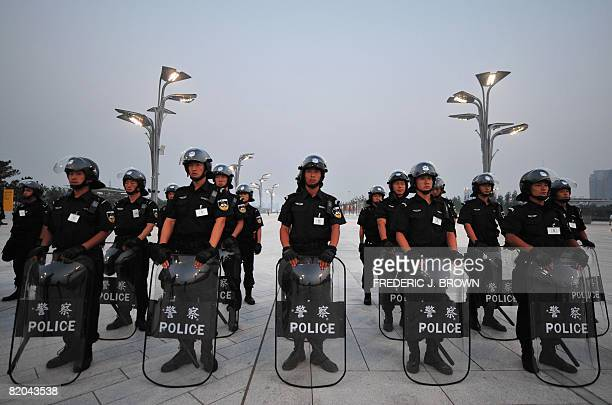 Members of a police SWAT team lineup outside the main Olympic Stadium also known as the Bird's Nest during security drill rehearsals on July 23 2008...