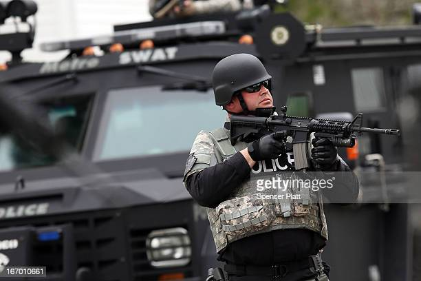 Members of a police SWAT team search through a neighborhood in Watertown as they search for 19yearold bombing suspect Dzhokhar A Tsarnaev on April 19...
