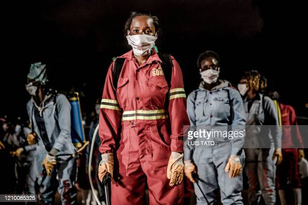 Members of a privately-funded NGO working with county officials wearing protective gather on April 15 during the dusk-to-dawn curfew imposed by the...