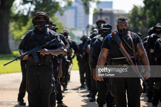 Members of a protestor group affiliated with NFAC, most carrying firearms, gather to march on July 25, 2020 in Louisville, Kentucky. The group is...