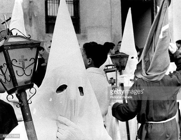 Members of a religious fraternity wearing capirote circa 1950 The conicaltopped costume popular among Catholics in Spain is frequently confused with...