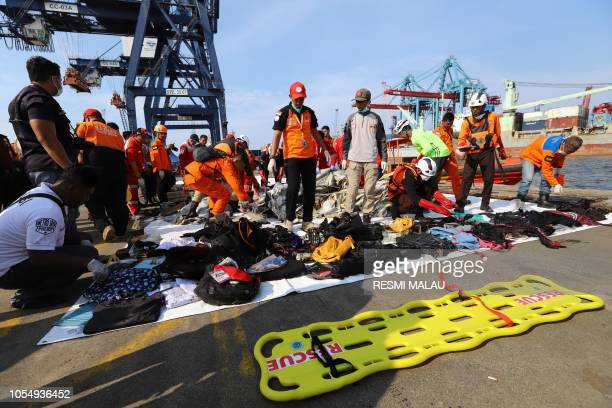 Members of a rescue team collect personal items and wreckage at the port in Tanjung Priok North Jakarta on October 29 after they were recovered from...