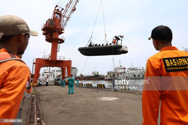 Members of a rescue team prepare to search for survivors from the Lion Air flight JT 610 which crashed into the sea at Jakarta seaport on October 29...