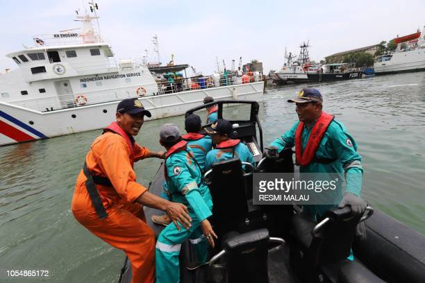 TOPSHOT Members of a rescue team prepare to search for survivors from the Lion Air flight JT 610 which crashed into the sea at Jakarta seaport on...